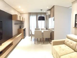 Sala integrada: Salas de estar  por Arquiteto em Casa