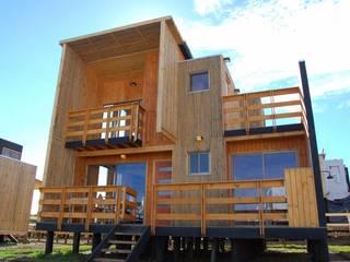 Cabañas Loft San Antonio: Terrazas  de estilo  por EstradaMassera Arquitectura