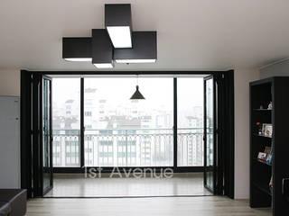 시크&모던 컨셉으로 꾸며진 모노톤 인테리어 : 퍼스트애비뉴의  거실,모던