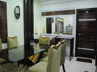 Dining room by Arturo Interiors