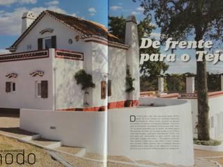Reabilitação de moradia em Mouriscas: Casas rústicas por Modo Arquitectos Associados