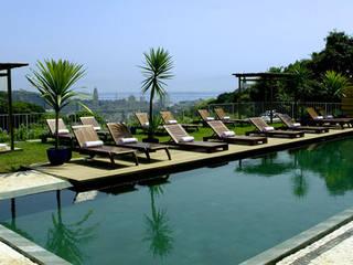 Hoteles de estilo  por Tato Bittencourt Arquitetos Associados