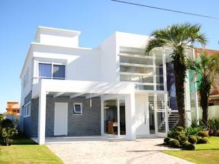 Casas minimalistas de Marcelo John Arquitetura e Interiores Minimalista