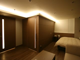 空想屋 (Koosoya Space Design Lab) Modern style bedroom Wood effect