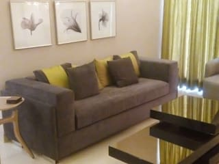 THE EXQUISITE HOME-NOIDA:   by FOYER INTERIORS,