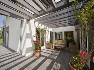 Casa prefabbricata in legno su progetto - Bifamiliare, Bologna Giardino d'inverno moderno di Spazio Positivo Moderno