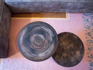 prachtig relief op tafels:  Woonkamer door IJzersterk interieurontwerp