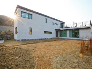 우리가 어떤 집을 짓는지 사진으로 얘기할께요 모던스타일 주택 by 한글주택(주) 모던