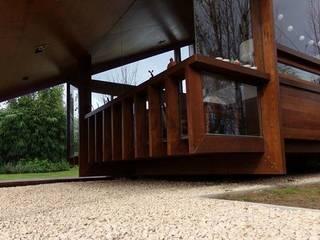 Ruang Keluarga oleh juan olea arquitecto, Rustic