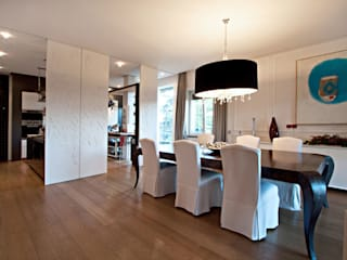 Modern dining room by Anomia Studio Modern