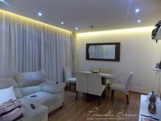 Ambiente de estar e jantar sóbrio e aconchegante: Salas de estar  por PRISCILLA BORGES ARQUITETURA E INTERIORES,