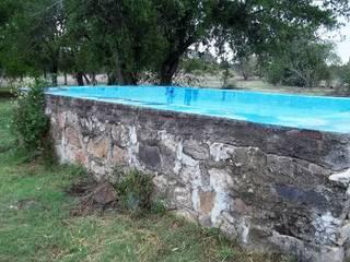 Casa de campo ubicada en barrio semi cerrado en la localidad de Tanti Liliana almada Propiedades Piscinas rústicas
