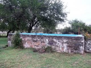 Liliana almada Propiedades Rustic style pool