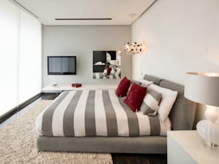 Dormitorios de estilo  por Línea Vertical