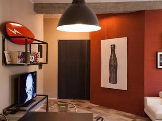 SURFER'S HOME: Soggiorno in stile  di STUDIO DOTT. ARCH. GIANLUCA PIGNATARO