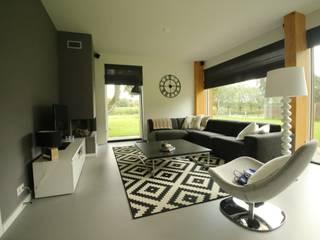Salas modernas de Hoogsteder Architecten Moderno Vidrio