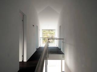 Pasillos, vestíbulos y escaleras modernos de mmarch gmbh - Mader Marti Architektur ETH SIA Moderno