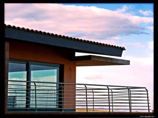 Casa Luna: Terrazas de estilo  de DAU arquitectos