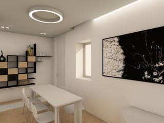 immagine dall'ingresso, tavolo ed elemento libreria e contenitori a parete:  in stile  di RDstudioarchitettura - daniele russo architetto