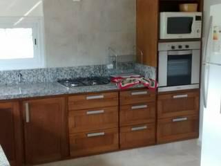 Belavista - Rio Ceballos - Córdoba Cocinas modernas: Ideas, imágenes y decoración de BULLK CONSTRUCTORA Moderno
