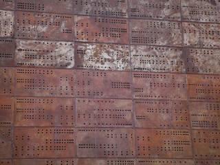 COCHERA: Oficinas y Tiendas de estilo  por CITTADINO