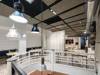 """RISTORANTE """"BELL"""": Negozi & Locali commerciali in stile  di Luca Braguglia Studio"""