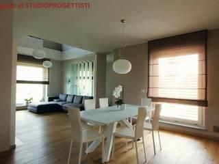 Salones de estilo moderno de StudioProgettisti - Nevio Maero Moderno