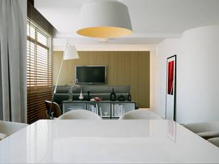 Apê MT+: Salas de estar  por Quattro+ Arquitetura