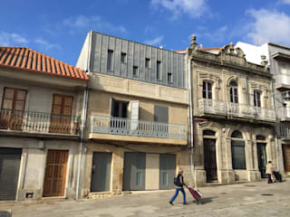 HUGA ARQUITECTOS Modern houses Stone