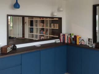 casa L&M: Finestre in stile  di Luca Braguglia Studio