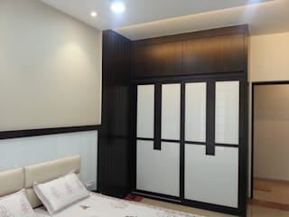 wardrobes:  Bedroom by NCA  naresh chandwani & associates