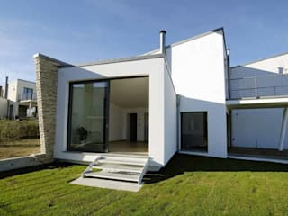 Modern houses by POMP0NI ASSOCIATI SRL Modern