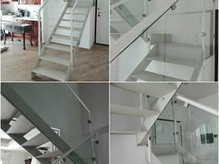 Parapetto: Ingresso & Corridoio in stile  di Aparo Creazioni
