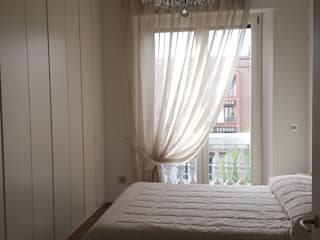 Bedroom by studio di architettura cinzia besana