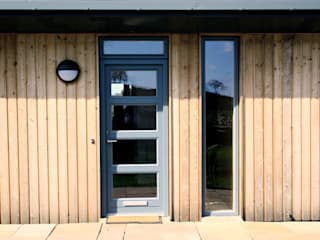 Timber clad entrance extension:   by Fife Architects