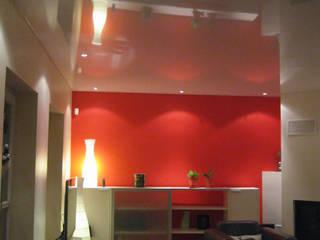 Wohnzimmer rote Wand Moderne Wohnzimmer von Mettner Raumdesign Modern