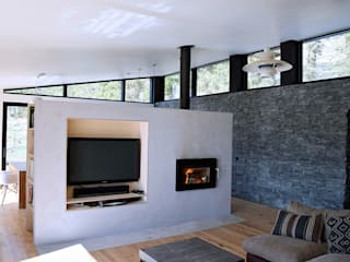 Concrete Hearth Wall:  Living room by Brown + Brown Architects