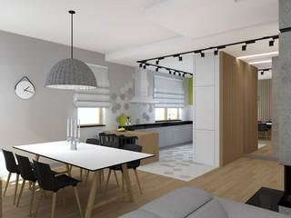 Aranżacja wnętrz domu Nowoczesna jadalnia od Free Form Pracownia Architektoniczna Nowoczesny