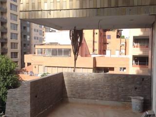 Balcones y terrazas modernos de John Robles Arquitectos Moderno