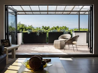 Región 4 Arquitectura Balcone, Veranda & Terrazza in stile eclettico