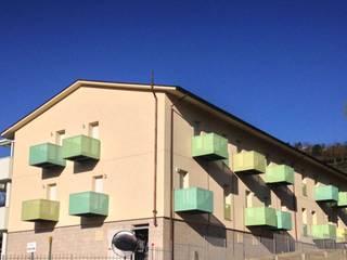 Modigliana Social Housing:  in stile  di Studio HOME