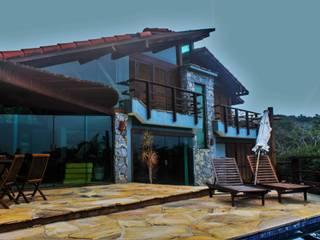 Casa Ferradura - Búzios: Casas  por Aroeira Arquitetura