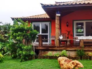Casas de estilo  por Aroeira Arquitetura, Tropical