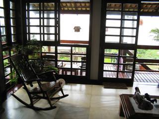 Salas / recibidores de estilo  por Aroeira Arquitetura, Rústico