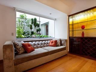 Sala de entretenimiento: Salas / recibidores de estilo  por Carughi Studio