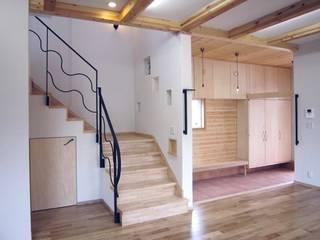 テラコッタタイルの土間です: 石井淳アトリエが手掛けた廊下 & 玄関です。