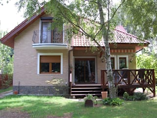 ITA Poland s.c. Rustic style house Bricks