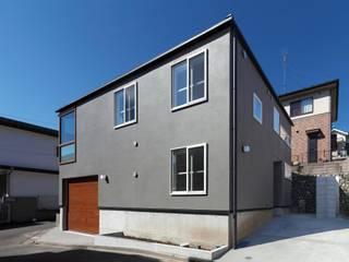 青梅のガレージハウス Kawakatsu Design モダンな 家