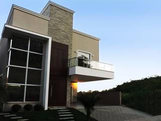 Casa QE148: Casas  por Cecyn Arquitetura + Design