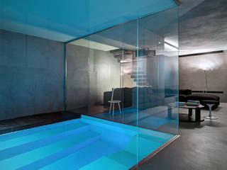 Casa Luna: Piscina in stile  di Buratti Architetti